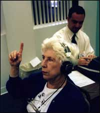 senior with presbycusis getting hearing test