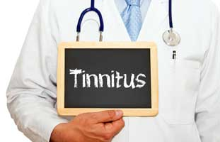 Doctor in lab coat holding chalkboard with word Tinnitus